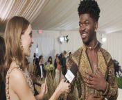 Lil Nas X talks with Emma Chamberlain about his transformative royal Versace outfit.